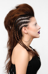 Fashion girl with professional hairstyle, braid and makeup.