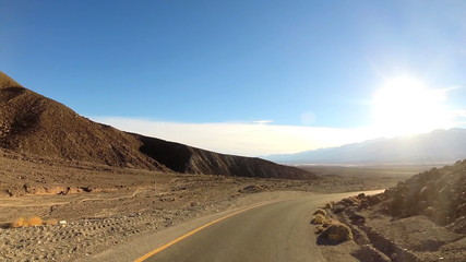 POV road trip Death Valley hot dry landscape vehicle motion California USA