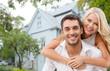 Leinwanddruck Bild - smiling couple hugging over house background