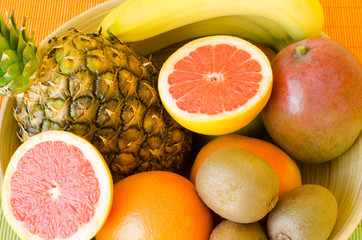Delicious tropical fruit in the wooden bowl