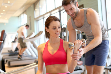 Fitness girl exercising with coach