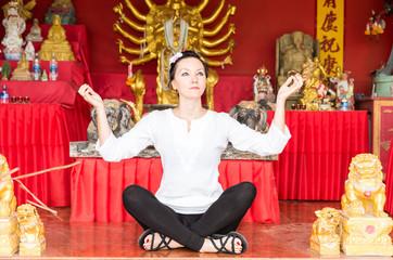 Young  woman praying and meditating buddha, Thailand, Phuket