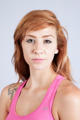Redhead woman in exercise outfit, looking focused