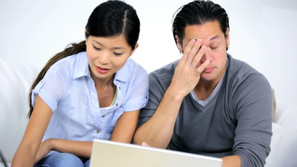 Young Asian Chinese Couple Money Worries Home Laptop Computer