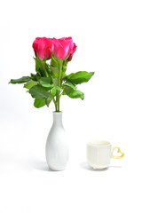 tea cup of love and pink rose in vase