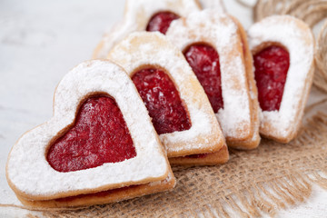 Heart shaped cookies with jam for valentine's day on textile