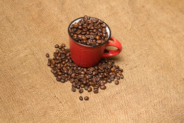 A cup with coffe beans