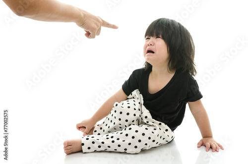 Leinwandbild Motiv Asian baby crying while mother scolding