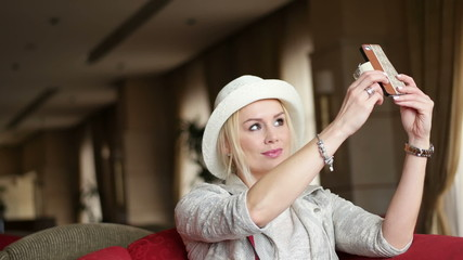 woman taking selfie with her smartphone