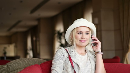 Pretty blonde woman using mobile phone