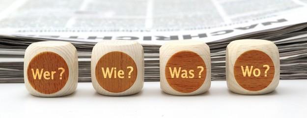 W-Fragen auf Holzwürfeln