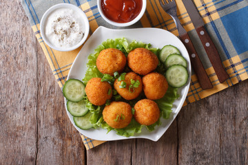 potato croquettes with sour cream and ketchup top view