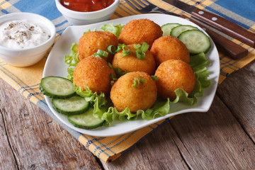 potato croquettes with lettuce and cucumber horizontal
