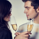 Portrait of young couple celebrating with champagne