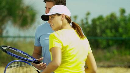 Close Up Young Caucasian Male Female Outdoor Tennis Players