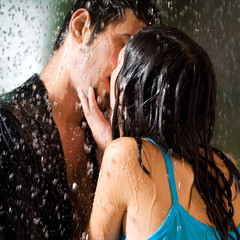 Couple hugging and kissing under a rain, outdoor