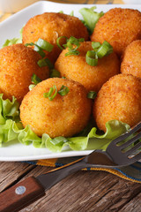 potato croquettes and vegetables close-up. Vertical