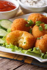 Potato balls deep fried on a plate  vertical