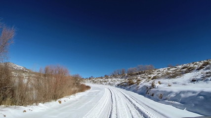 POV driving barren landscape blue dry climate vehicle transport Zion Utah USA