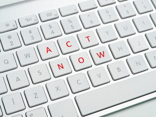 Act now text on computer keyboard