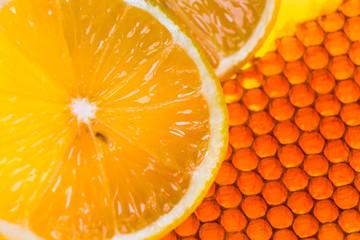 yellow honeycomb with fresh honey and lemon