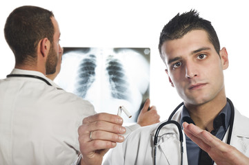 male doctor looking at the x-ray and advised to stop smoking