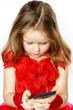 Cute  little ballerina dressed in red  taking a selfie photo