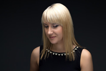 Photo of young blond woman looking down