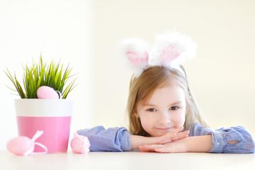 Adorable little girl wearing bunny ears on Easter