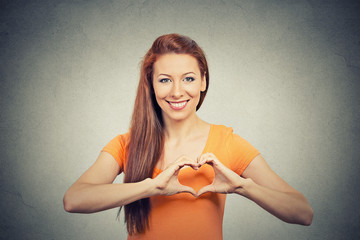 portrait smiling cheerful happy woman making heart sign hands