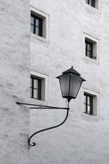 Lantern on a light gray house wall