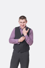 young man fastening cuffs on the shirt