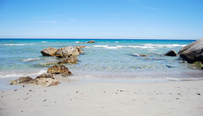 landscape with coastal sea shore, waves, crystal clear water and