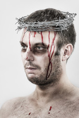 Bleeding man with crown of barbed wire