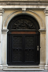 Fragment of a facade with forged doors, Venice