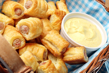 White sausage in puff pastry with joppie sauce