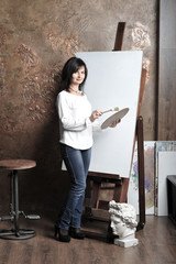 girl painting on the easel