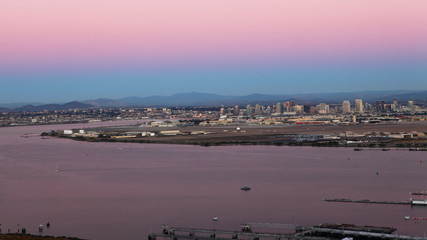 A timelapse view of the San Diego skyline as day turns to night