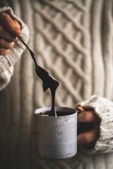 Woman holding mug of chocolate