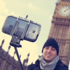 man taking a selfie in front of the Big Ben in London, United Ki