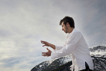 Man practicing Tai Chi, Yoga and Qi Gong