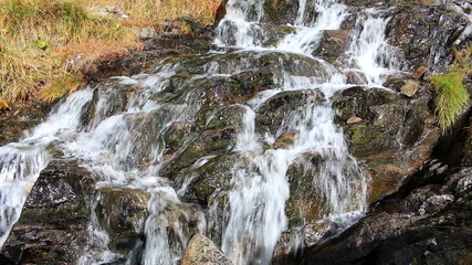 Beautiful veil cascading waterfall, mossy rocks