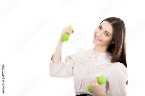 Young business woman with dumbbells - 77020936