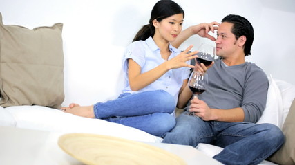 Young Ethnic Male Female Relaxing Home Drinking Glass Wine