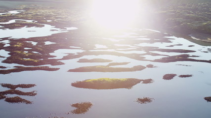 Aerial sun flare glacial meltwater lake nature wild birds volcanic Iceland