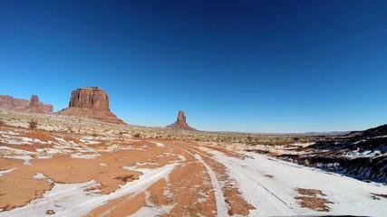 POV winter drive snow sun flare Colorado Plateau desert Monument Valley Arizona USA