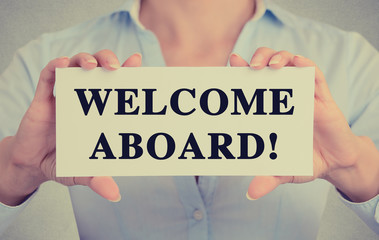 Businesswoman hands holding card sign welcome aboard message