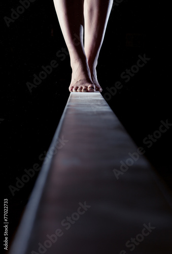 feet of gymnast on balance beam Canvas Print