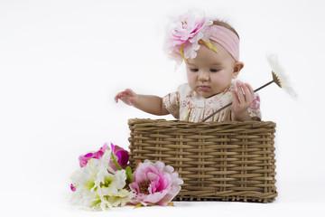 beautiful baby girl in a basket