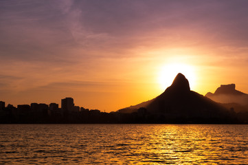 View of Rio de Janeiro Sunset Behind Mountains at the Lake